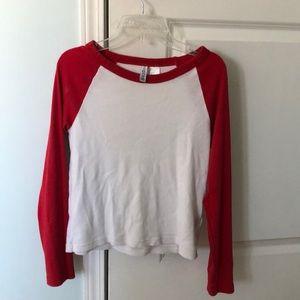 Red and white baseball long sleeve shirt.